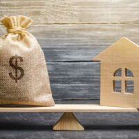bigstock-A-Money-Bag-And-A-Wooden-House-281344012.jpg