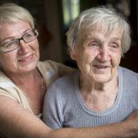 bigstock-An-elderly-woman-with-her-adul-131370128-1.jpg