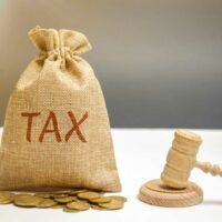 bigstock-Bag-Of-Money-And-The-Word-Tax-275040682.jpg