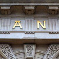 bigstock-Bank-sign-above-the-door-of-fi-237350935.jpg