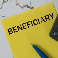 bigstock-Beneficiary-Word-On-Yellow-She-376518958-1.jpg