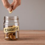 bigstock-Charity-Glass-Jar-With-Coins-245191120.jpg