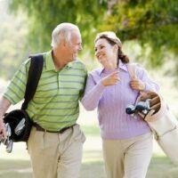 bigstock-Couple-Enjoying-A-Game-Of-Golf-5637433.jpg