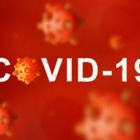 bigstock-Covid-Coronavirus-Under-Mic-356406974.jpg
