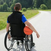 bigstock-Disabled-Young-Basketball-Play-307414894.jpg