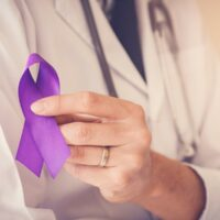 bigstock-Doctor-Hands-Holding-Purple-Ri-255339793.jpg