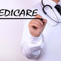 bigstock-Doctor-Writing-Word-Medicare-W-351532553.jpg