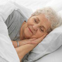 bigstock-Elderly-woman-sleeping-in-bed-175715944.jpg