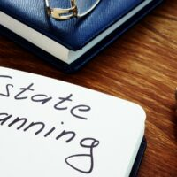 bigstock-Estate-Planning-Handwriting-Si-344646019.jpg