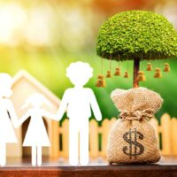 bigstock-Family-With-Paper-Cut-And-Mone-258521080.jpg