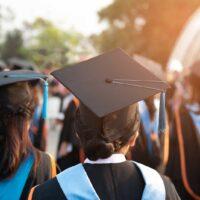bigstock-Graduates-Wear-Black-Hats-Bla-280438603.jpg