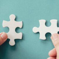bigstock-Hands-With-Jigsaw-Puzzle-Piece-348576142.jpg