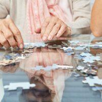 bigstock-Hands-of-seniors-playing-puzzl-236835304.jpg