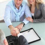 bigstock-Happy-couple-signing-purchase-17011214.jpg