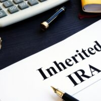 bigstock-Inherited-Ira-Documents-On-A-T-269314111.jpg