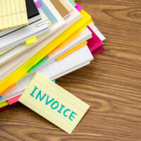 bigstock-Invoice-The-Pile-Of-Business-206701705.jpg