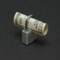 bigstock-Locked-Money-2295156.jpg