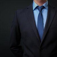 bigstock-Man-In-Black-Blue-Suit-With-Ti-337551472.jpg