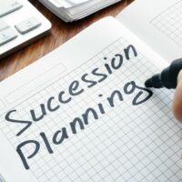 bigstock-Man-Is-Writing-Succession-Plan-280949761.jpg