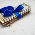bigstock-Money-Gift-Box-And-A-Lot-Of-Mo-303237775.jpg