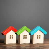 bigstock-Multi-colored-Wooden-Houses-A-337245376.jpg