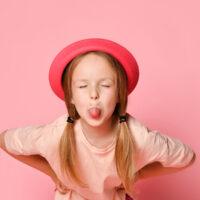 bigstock-Naughty-Little-Girl-Leans-Forw-385040039-1.jpg