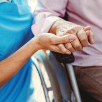 bigstock-Nurse-consoling-a-senior-woman-323943850-2.jpg