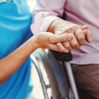 bigstock-Nurse-consoling-a-senior-woman-323943850.jpg