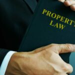 bigstock-Property-Law-In-The-Hands-Of-A-322331236.jpg