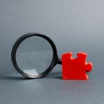 bigstock-Red-Puzzle-And-Magnifying-Glas-299196673.jpg