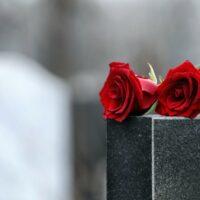 bigstock-Red-Roses-On-Black-Granite-Tom-341667772.jpg