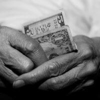 bigstock-Senior-Struggling-Financially-4802263.jpg