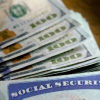 bigstock-Social-Security-cards-with-cas-282810331.jpg