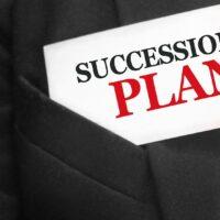 bigstock-Succession-Plan-Words-On-A-Car-402061361.jpg