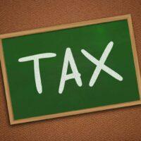 bigstock-Tax-Motivational-Business-Wor-312945061.jpg