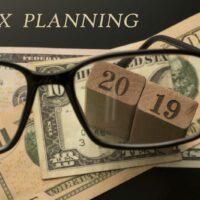 bigstock-Tax-Planning-Concept-Glasses-277536949.jpg