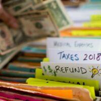 bigstock-Tax-Refund-Doing-Taxes-Person-229479802.jpg