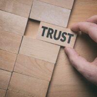 bigstock-Trust-Word-Written-On-Wooden-B-291450460.jpg