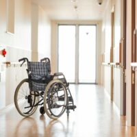 bigstock-Wheelchair-in-the-corridor-of-326010865.jpg