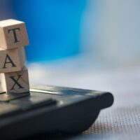 bigstock-Wooden-Cubes-With-Word-Tax-And-270599380.jpg